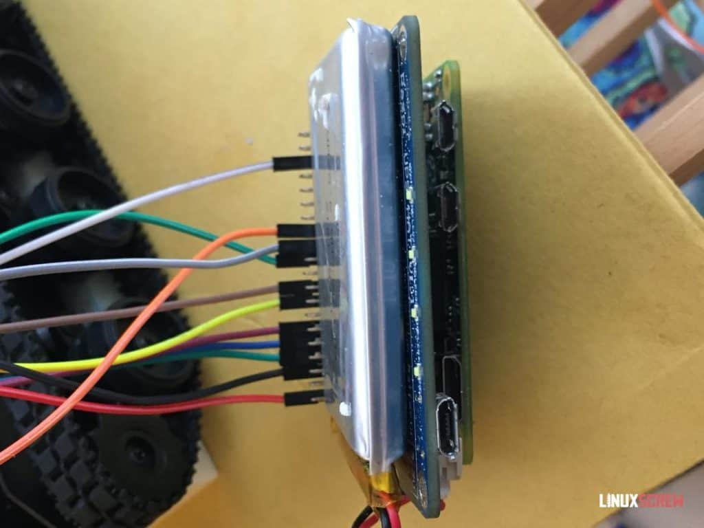 Pi with the wires and a battery pack attached